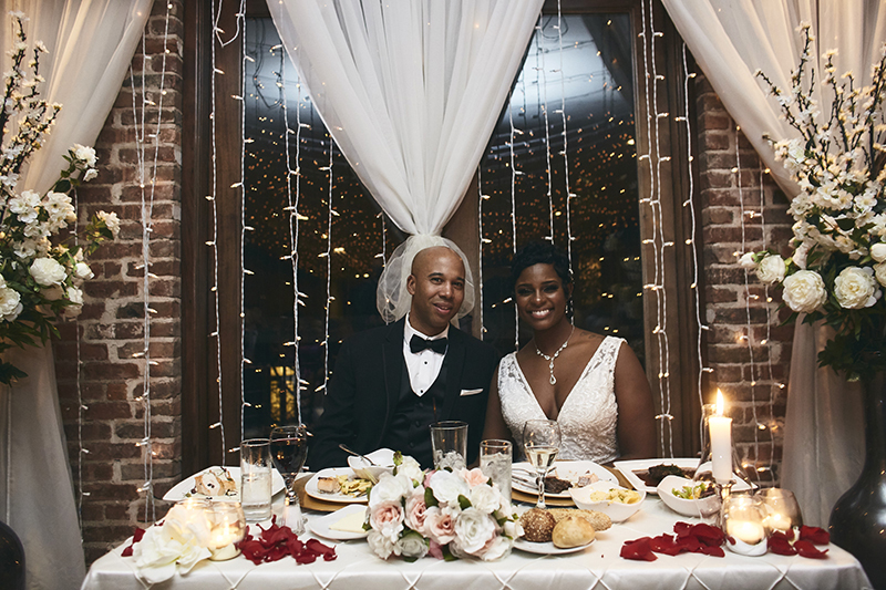 Bride and groom sitting at the table