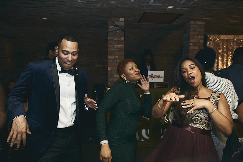 People dancing at the party after the wedding ceremony