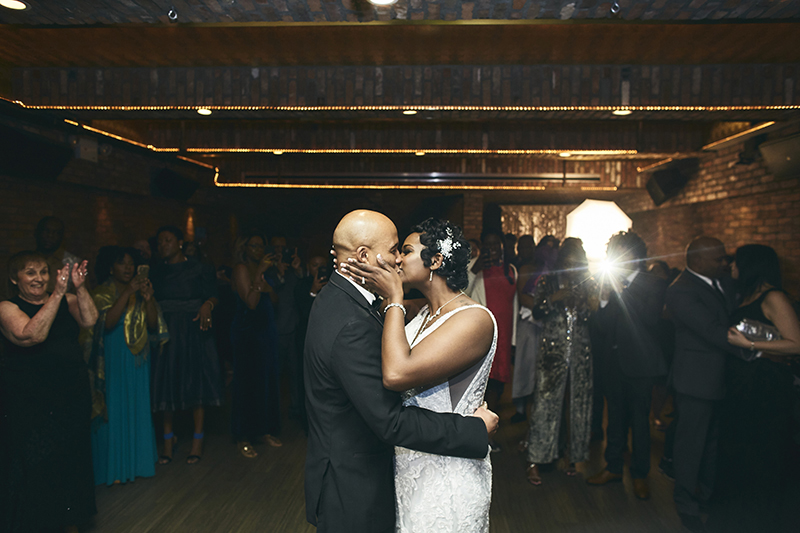 Bride and groom kissing during the wedding dance