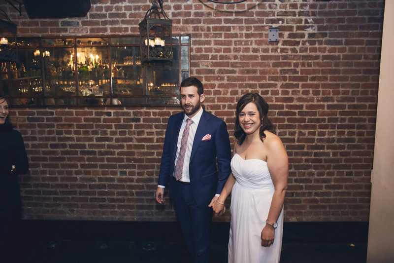 bride and groom coming to wedding party