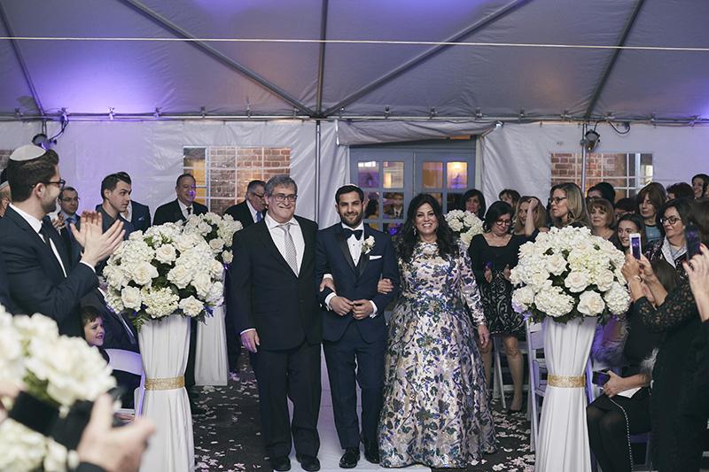 Orthodox Jewish groom walking down the aisle