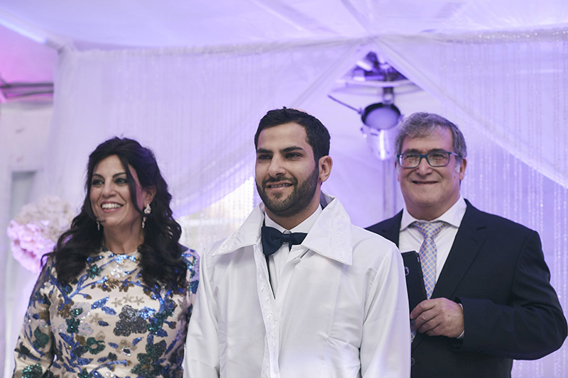 Orthodox Jewish groom with parents