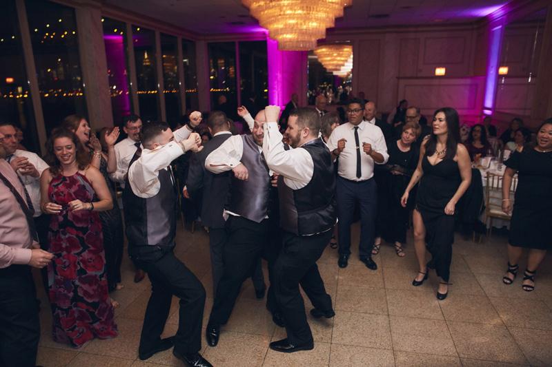groom with groomsman dancing at  Giando on the Water Wedding