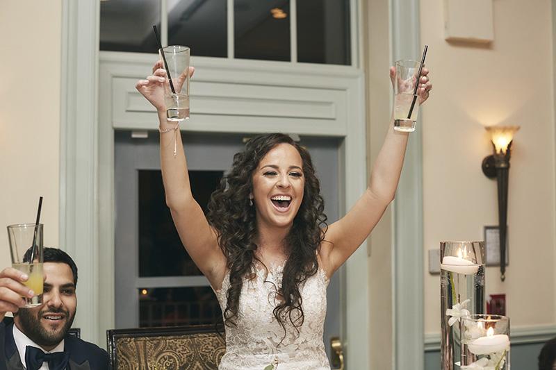 bride raising glasses
