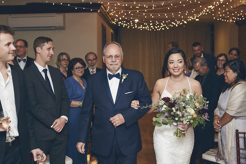 bride walking down the isle with father