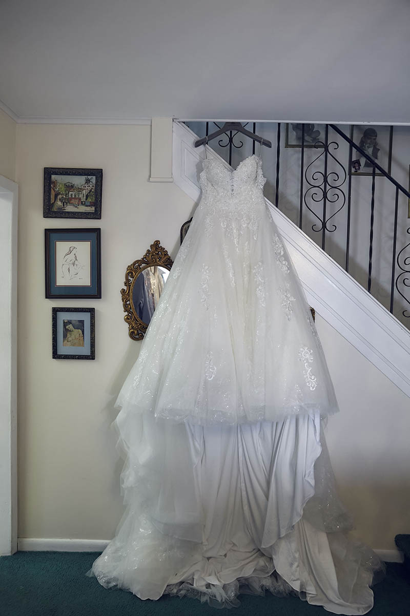 Bride's wedding dress hanging