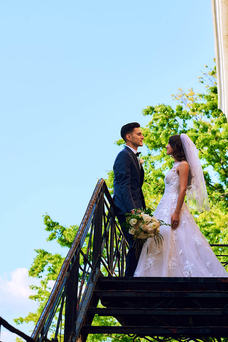 Bride and groom on top of fire escape