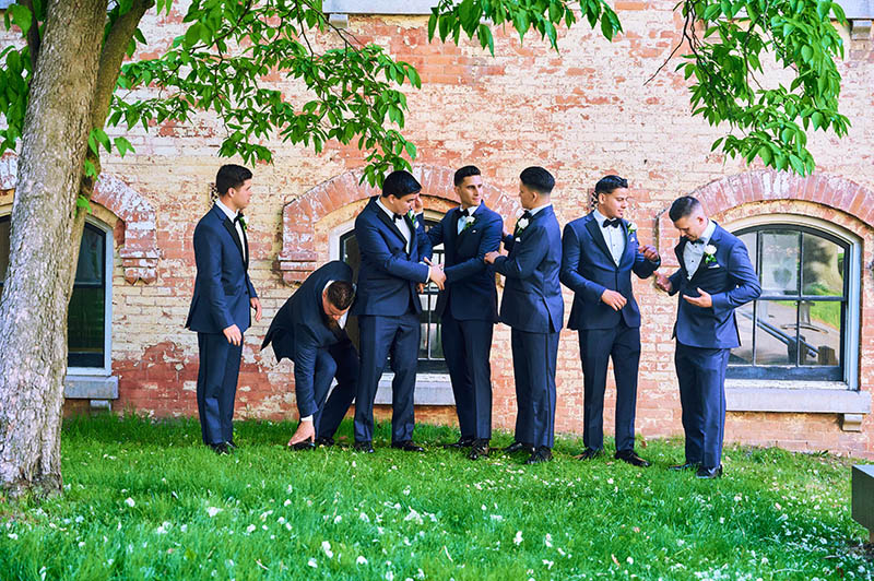 Groomsmen getting ready for a photo