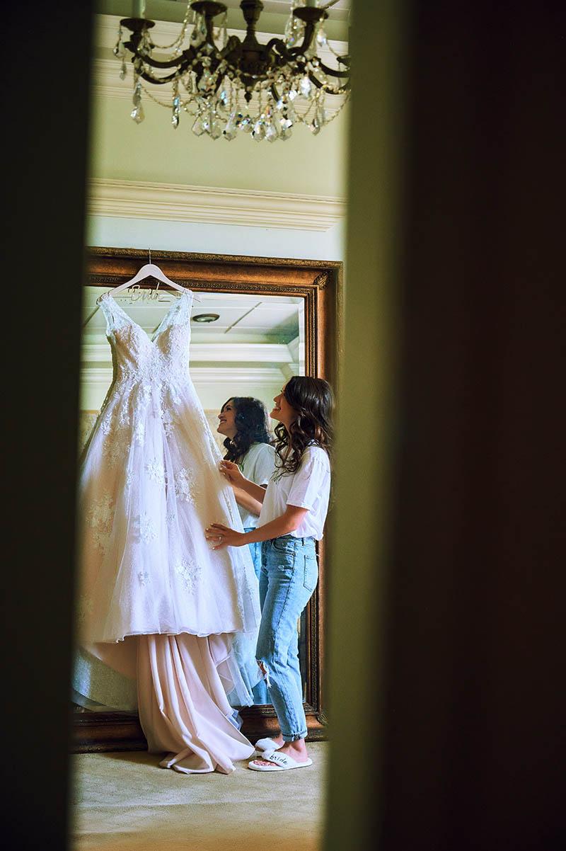 Bride touching the wedding dress
